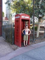 Hannah in a red telephone box